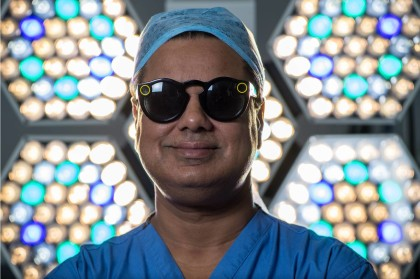 Surgeon Shafi Ahmed poses for a photograph wearing a pair of Snap Inc. Spectacles inside his operating theater at the Royal London Hospital, part of the Barts Health NHS Trust, in London, U.K., on Thursday, Jan. 11, 2018. Chris J. Ratcliffe—Bloomberg/Getty Images